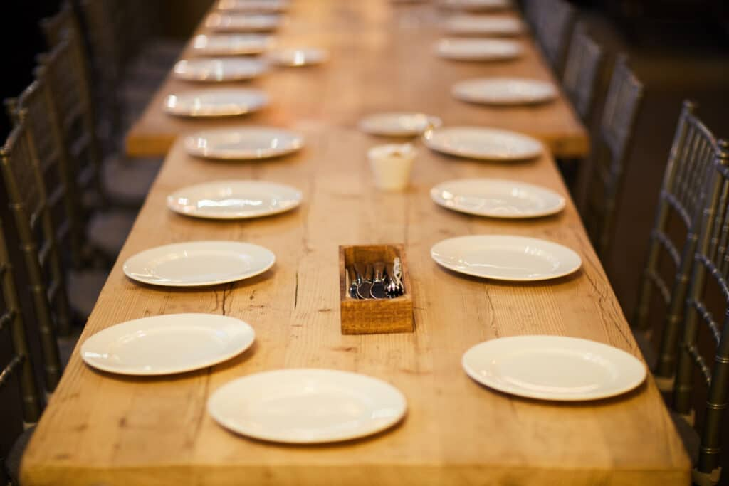 Banquet table with empty plates