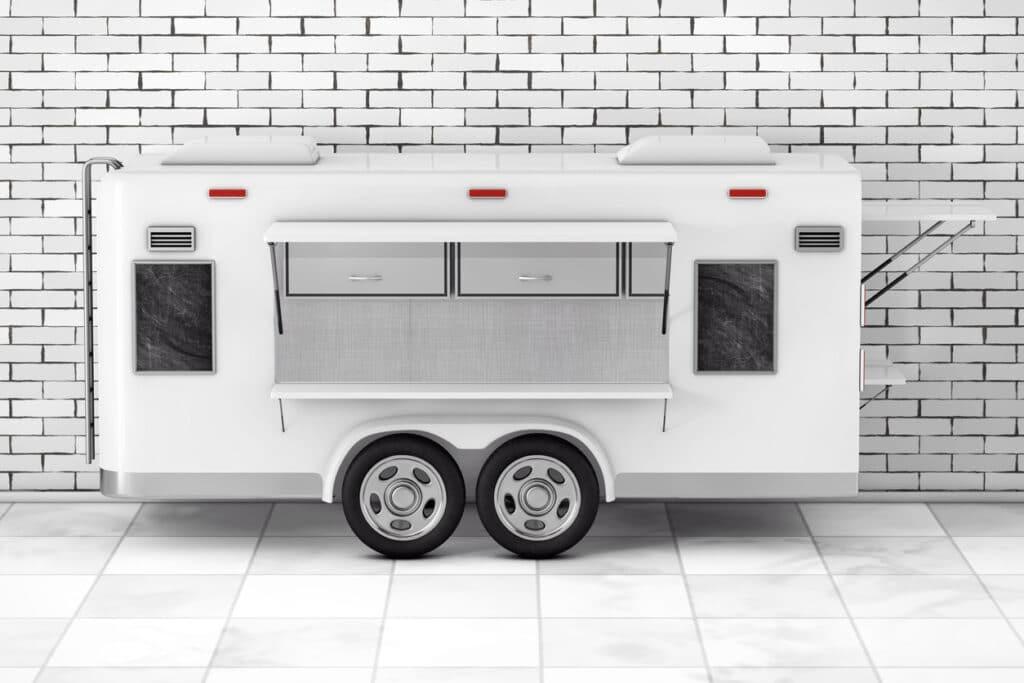 Airstream Caravan Food Truck in front of brick wall. 3d Rendering